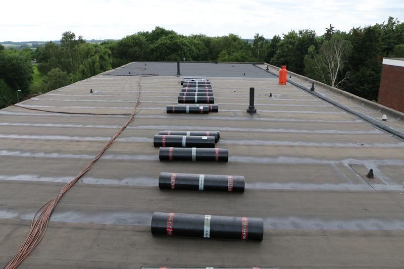 Image 81 - New Felt Flat Roof in progress over block of flats in Harlow