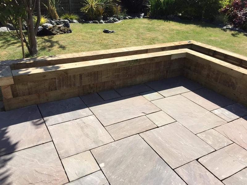 Image 17 - Paving with sleeper plant bed surrounds