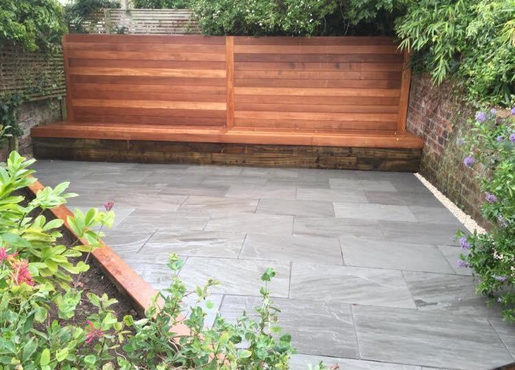 Image 7 - Smooth balau hardwood seating, grey riven sandstone with sleeper edges capped in balau to match