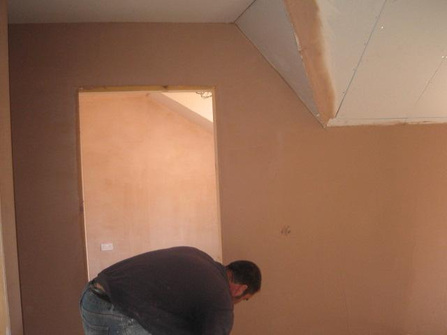 Image 11 - Dave plastering a small bedroom June 2011