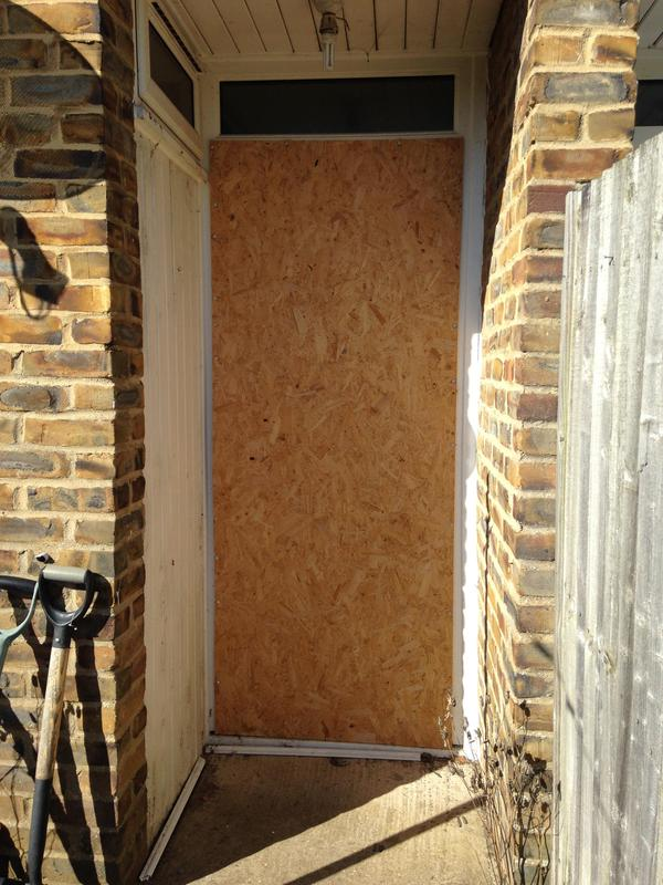 Image 12 - old back door had been boarded up from insurance company