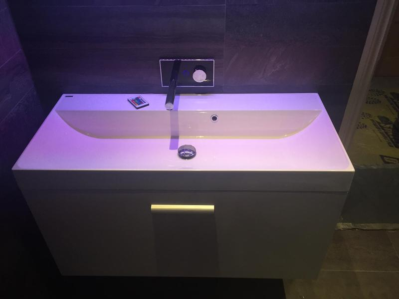 Image 16 - A matching digital wall hung basin unit with LED lights for a complete bathroom design.