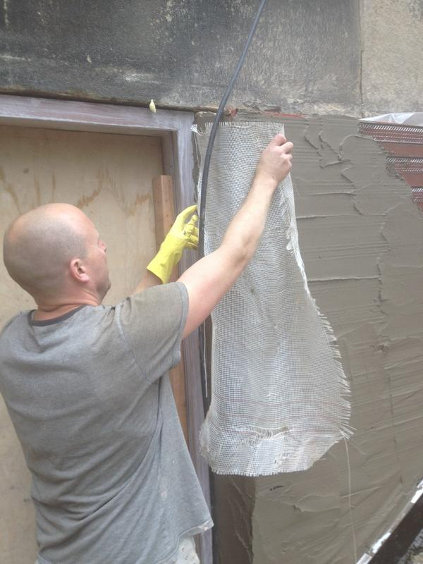 Image 109 - Alkali resistant mesh put into sand cement render