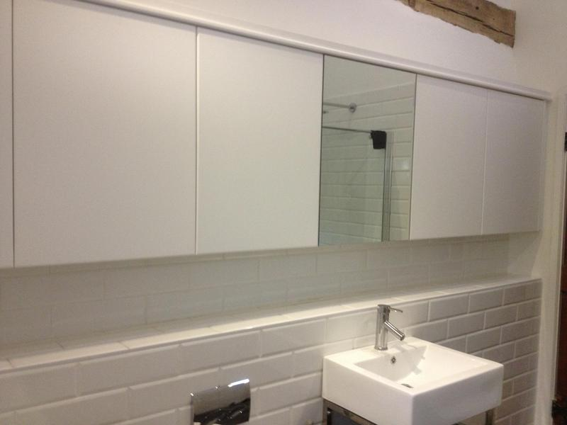 Image 27 - Long bespoke vanity cabinet , with polyester spray finished doors .