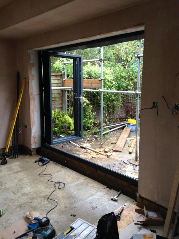 Image 16 - during installation of aluminium anthracite grey bi fold doors