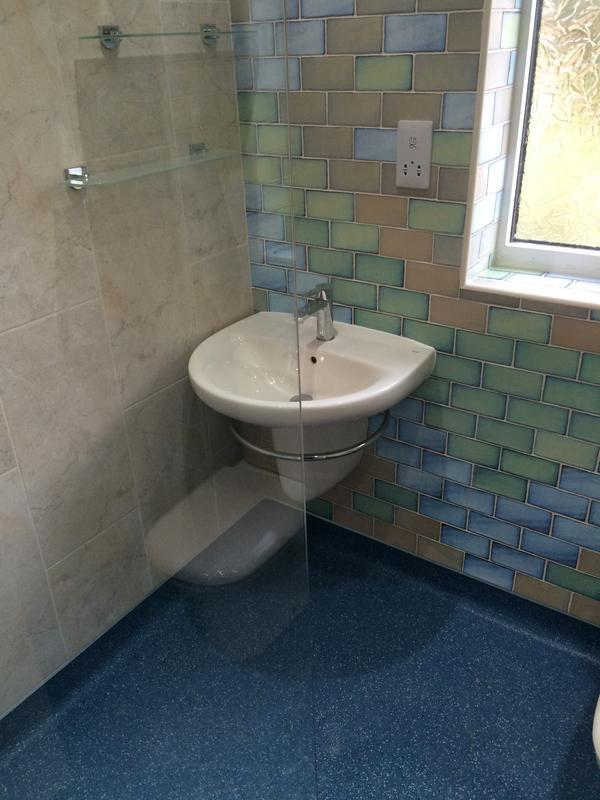 Image 18 - Wet Room With Wall Hung Semi Ped Basin And Bespoke Tiling