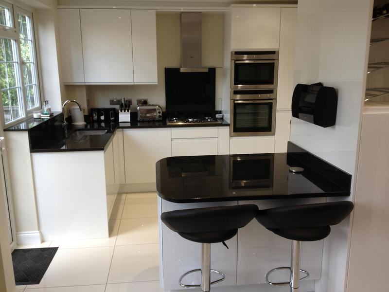 Image 105 - Small handleless gloss kitchen installed in a knock through kitchen/diner refurbishment.