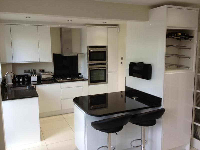 Image 106 - Small handleless gloss kitchen installed in a knock through kitchen/dinner refurbishment.