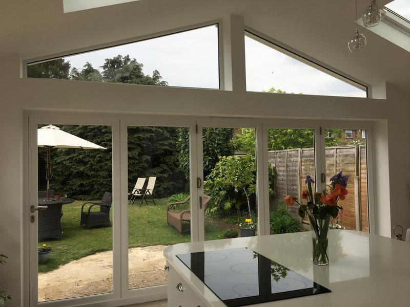 Image 8 - Rear extension with bifold doors & shaped glass.