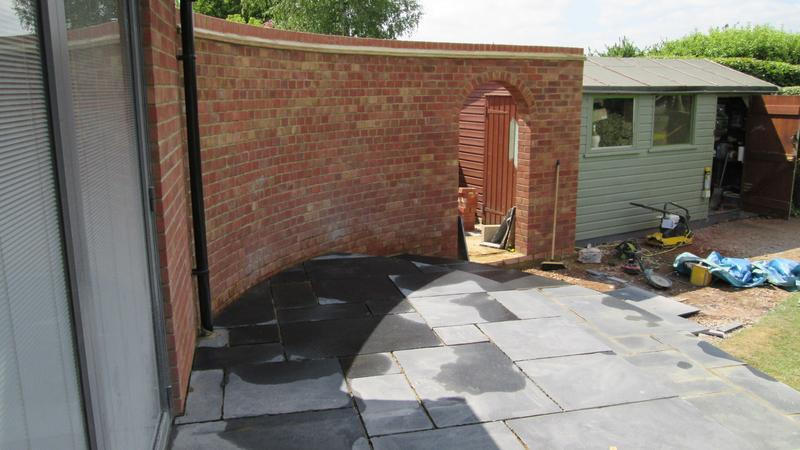 Image 8 - 2.4m(H) x 225mm(W) Radius wall with arch finished with tile creasing and brick on edge