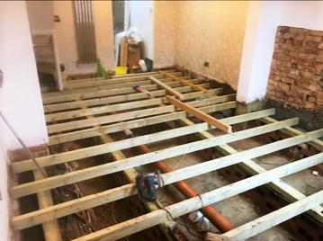 Image 21 - Dry Rot Treatment: fitting new joists onto new wall plates and sleeper walls