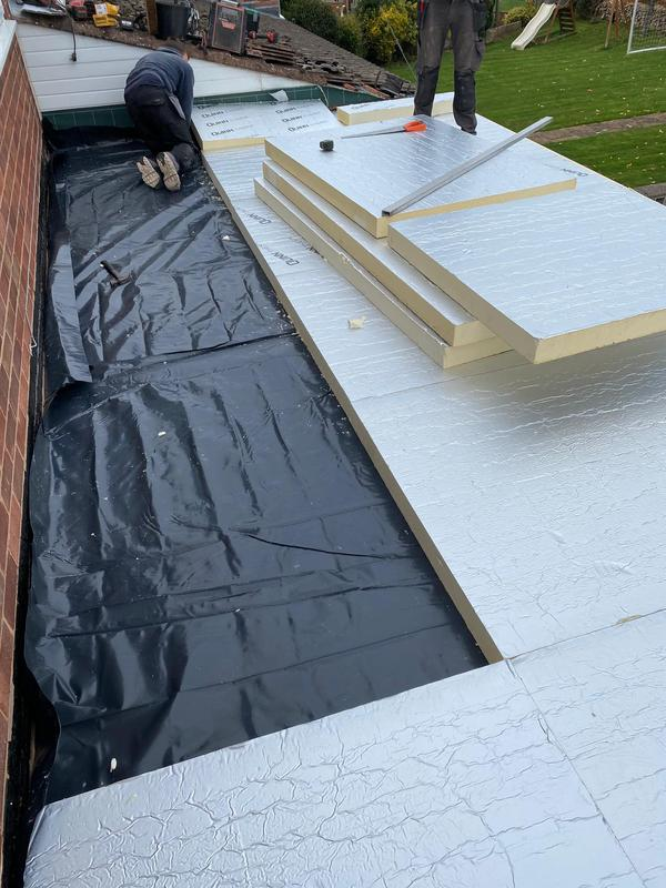 Image 14 - EPDM roof insulation being installed by the team