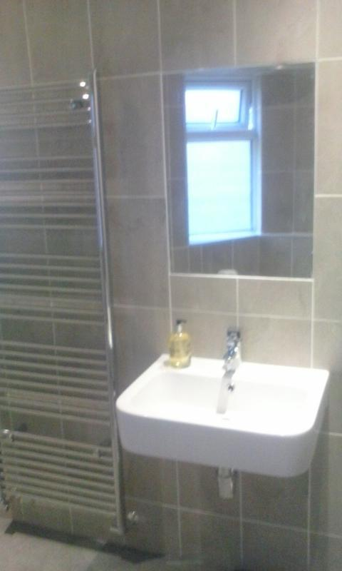 Image 9 - This was a very damp, difficult bathroom which required removal of a structural wall. Features complete tiling with inset mirror.