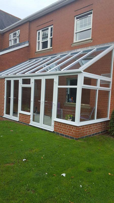 Image 4 - existing customers with a new high pitch glass roof in coalville