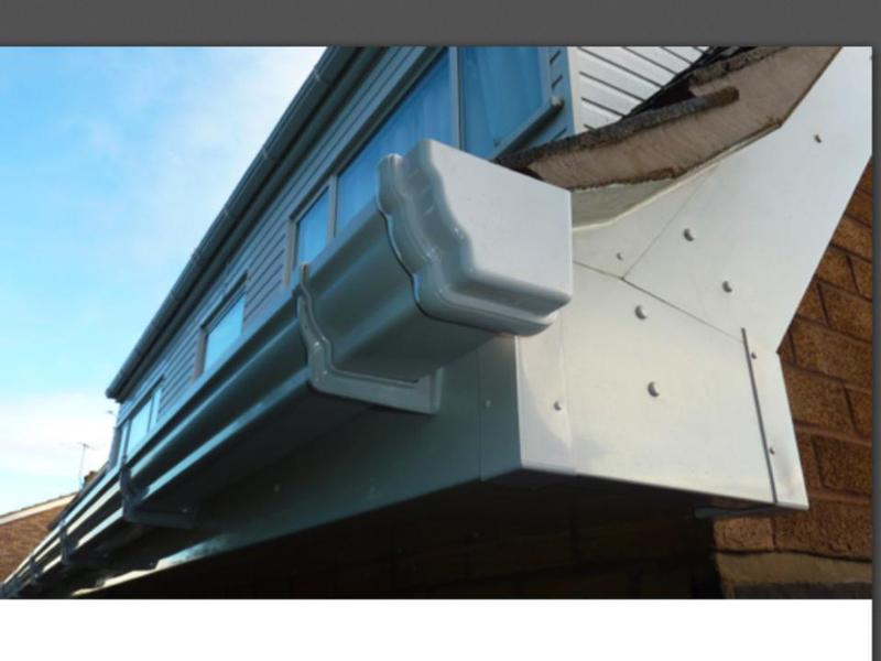 Image 21 - After with new high white upvc cladding facia boards and new white og deep flow guttering