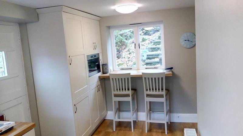 Image 2 - The same kitchen as above - featuring a solid oak breakfast bar beneath the window.
