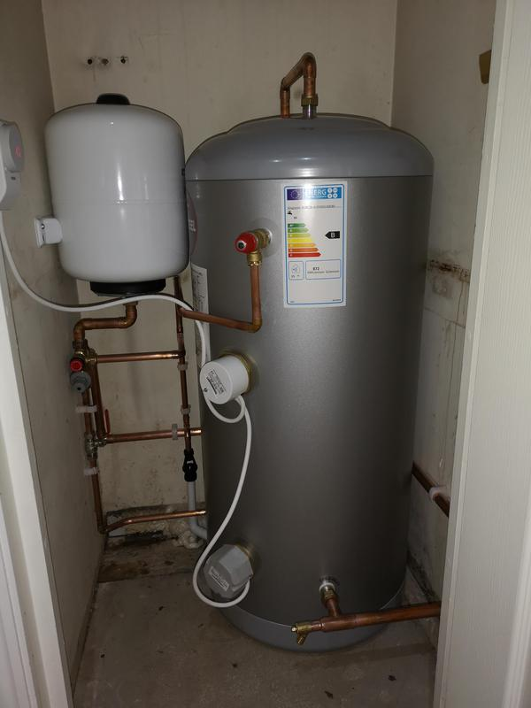 Image 19 - Old hot water cylinder and cold water storage tank removed. New direct unvented cylinder fitted with WiFi hot water controls.