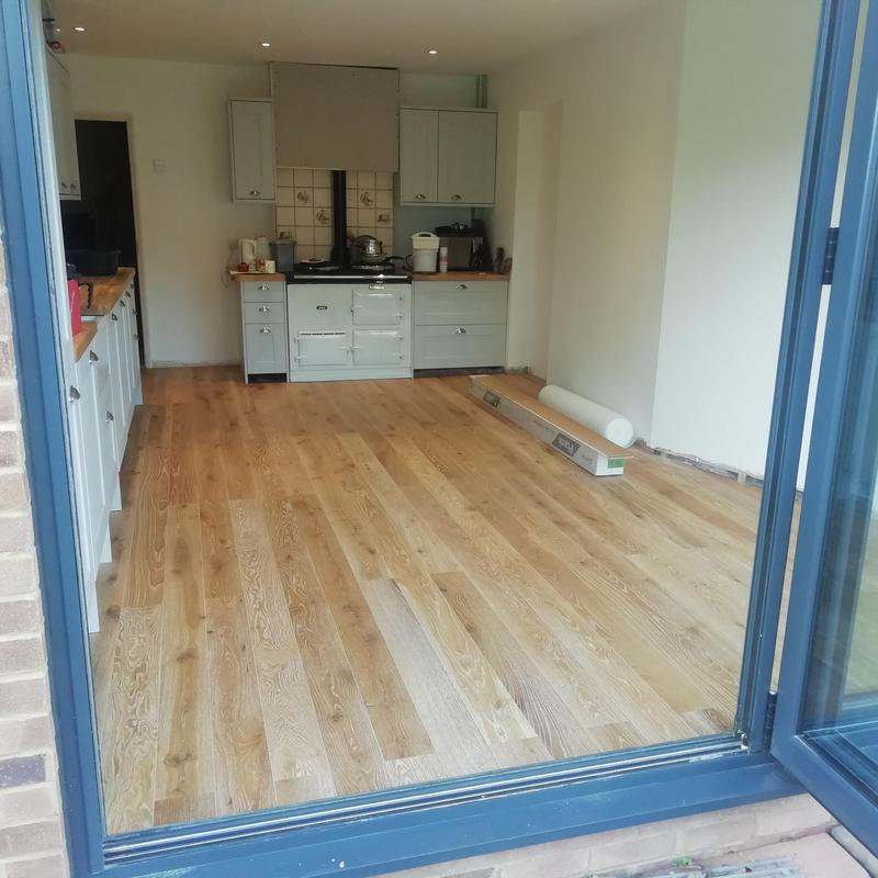 Image 23 - Engineered wooden flooring laid in new kitchen space.