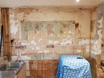 Image 12 - Kitchen refurbishment works which included the demolition of walls, over boarding and plastering and upgrading the electrics.