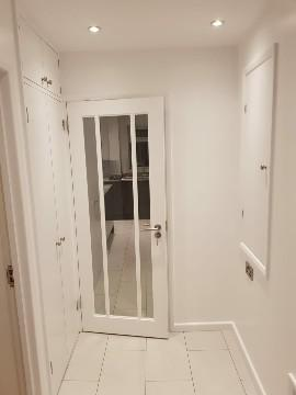 Image 6 - Kitchen refurbishment works which extended into the hall way, a new stud wall was built, new doors supplied and fitted and a cupboard integrated into the wall to house the fuse board