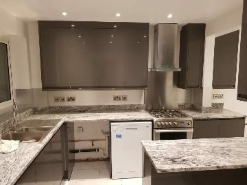 Image 8 - Kitchen refurbishment works which included extra double sockets above the work top in brushed chrome and complimented by the aluminium splash back