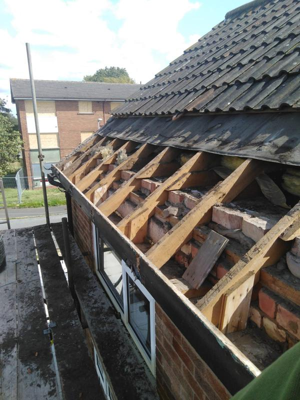 Image 7 - A recent pitched roof replacement,we start by removing the old rotten felt.