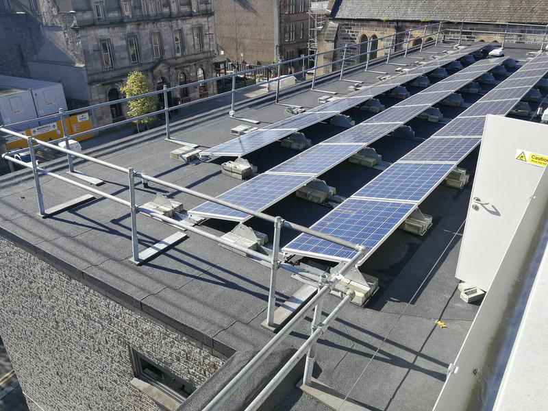 Image 8 - solar panels installed on flat roof