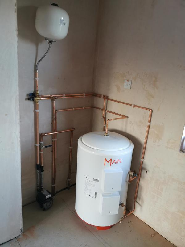 Image 2 - 120 litre unvented direct cylinder installed, with a 50 gallon holding tank and 2 bar Stuart Turner Monsoon pump