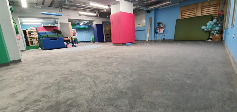 Image 17 - My Gym in Crouch End wanted to replace their carpet at the kids play area. The job required special skills for the circular die cut. Cloud 9 Underlay for better sound reduction impact was used. This picture is after.