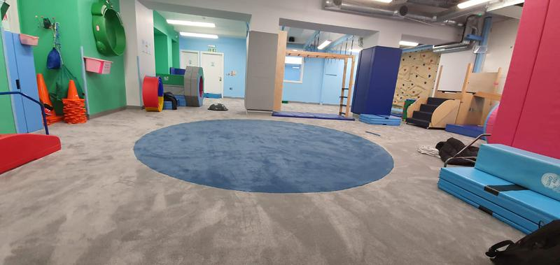 Image 18 - My Gym in Crouch End wanted to replace their carpet at the kids play area. The job required special skills for the circular die cut. Cloud 9 Underlay for better sound reduction impact was used. This picture is after.
