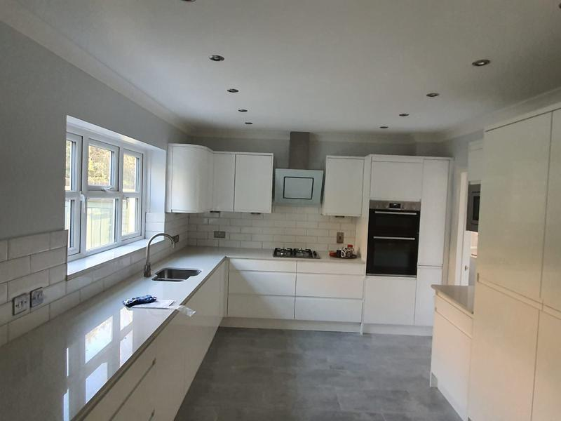 Image 6 - Gloss white kitchen with modern appliances
