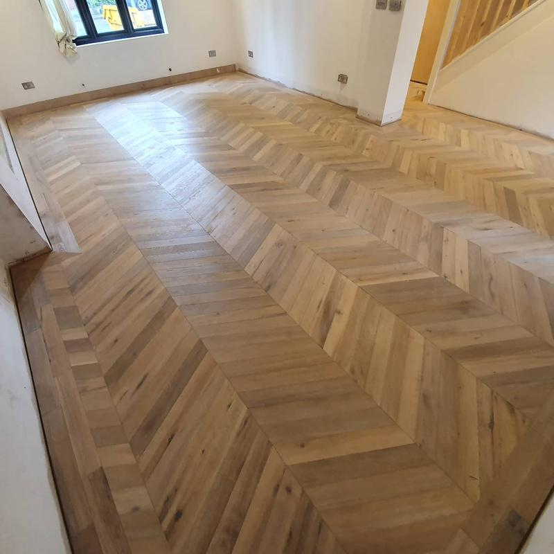Image 37 - Chevron engineered flooring with double border. Supplied and fitted