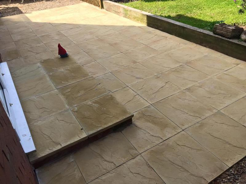 Image 181 - Patio installed with a step to match the same slabs we played to the customers choice.