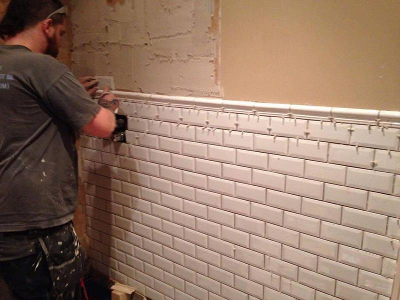 Image 176 - Continuing wall tiling.