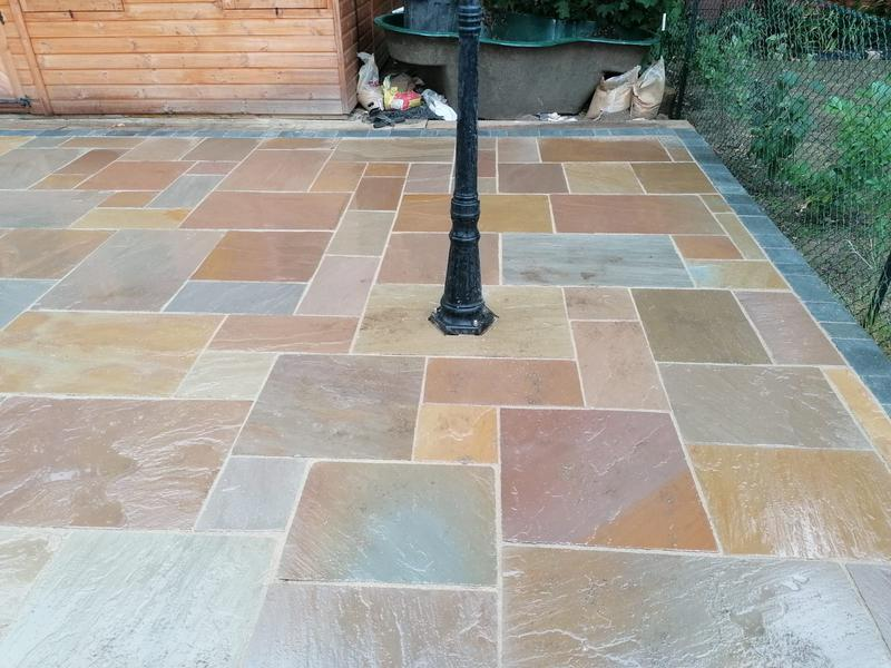Image 29 - A 50 metre squared patio in a buff harvest colour, finished with a mushroom coloured jointing compound. We have also installed a small street light to add an extra feature for such a large patio.