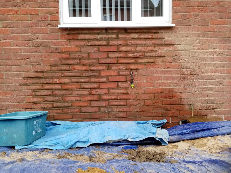 Image 6 - Old bricks taken out and brick stitching inserted.. Helical bars and resin and replace cracked bricks with new
