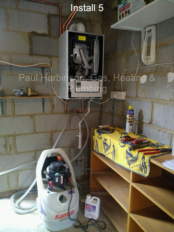 Image 2 - The new boiler. New blockwork. Photo shows Powerflush machine which is used to rejuvenate the central heating system.