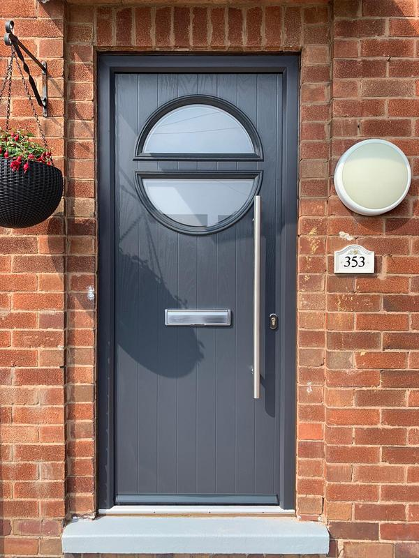 Image 3 - 'Arnold' composite door in anthracite grey with a 1200mm stainless steel bar handle recently installed in Bestwood.