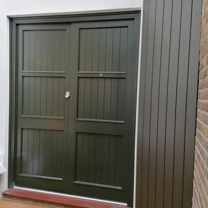 Image 3 - Spray finished tongue and groove section to imitate the factory finished doors, using graco airless sprayer and dulux Weathershield quick dry satinwood.