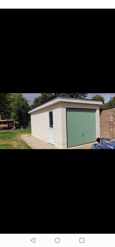 Image 32 - Here we recently completed a full garage build from the footings up. We installed a single pvc door for side entrance and a double french door to the rear. Finished with an ivory k render. A very happy customer once again.