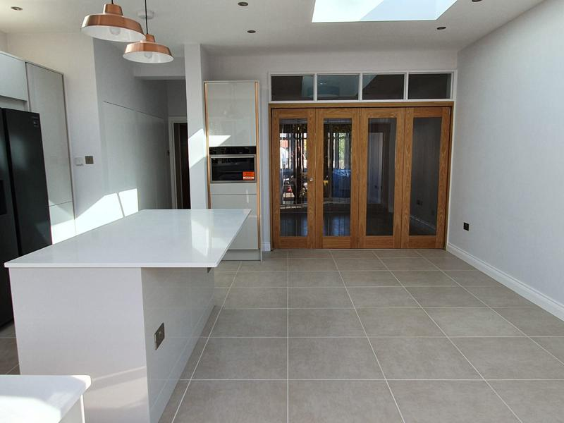 Image 5 - Rewiring, plastering, decoration, tiling, kitchen installation.