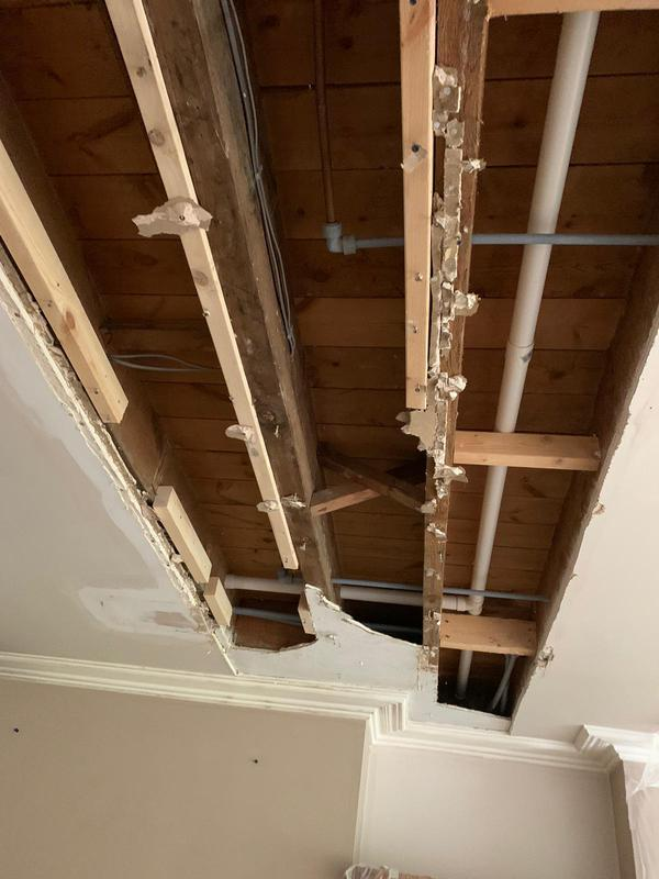 Image 19 - Water damaged ceiling re-boarded and plastered