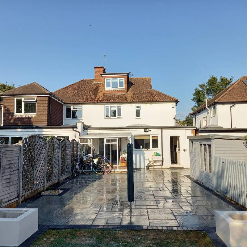 Image 30 - Here we have installed a 70m2 grey indian sandstone patio. Finished with a charcoal block paver band/border. Also we have built 2 box planters finished with a white coloured render.