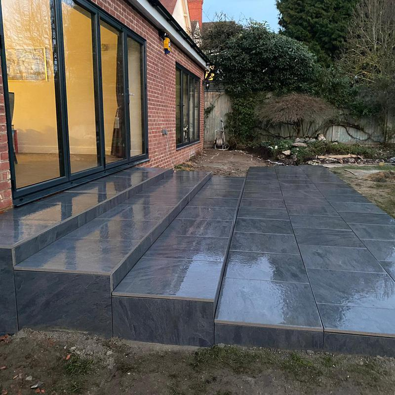 Image 1 - A complete transformation we have made here using an anthracite grey paving slab, we have build a symmetrical set of steps to the underside of each bi-folding patio door on this new extension in Reigate,Surrey. A very happy customer so far. Lots of pictures to follow.