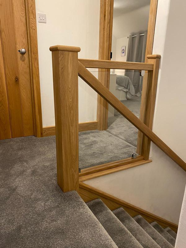Image 7 - Recent glass balustrade installation with oak handrails and oak cladding on existing newell posts and stair strings.