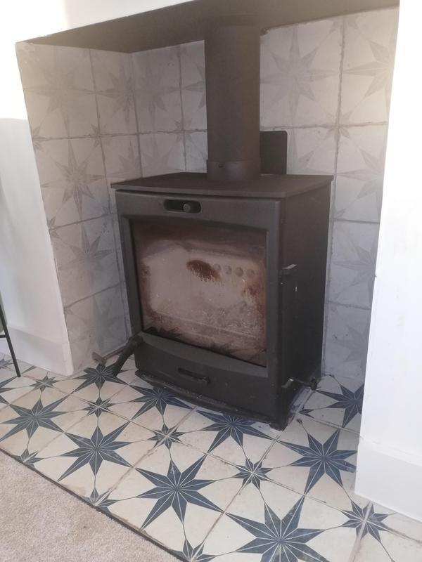 Image 3 - Stylish tiling around this log burner