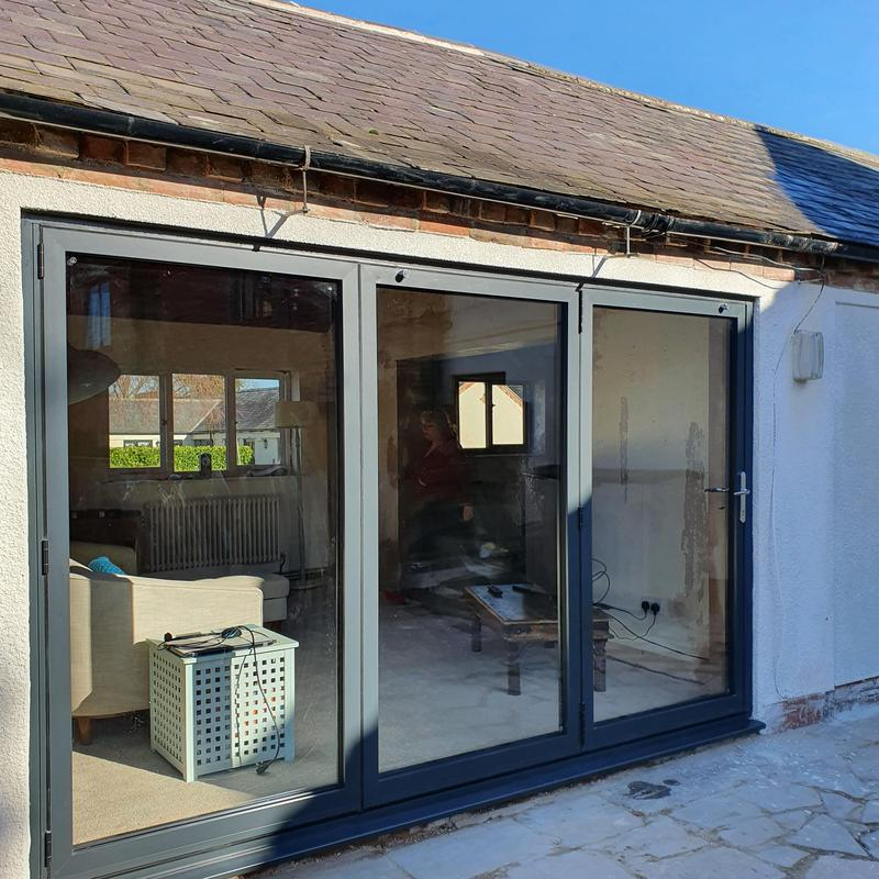 Image 31 - 3-Leaf sliders UK Anthracite Grey Aluminium Bi-fold door installed in Gamston