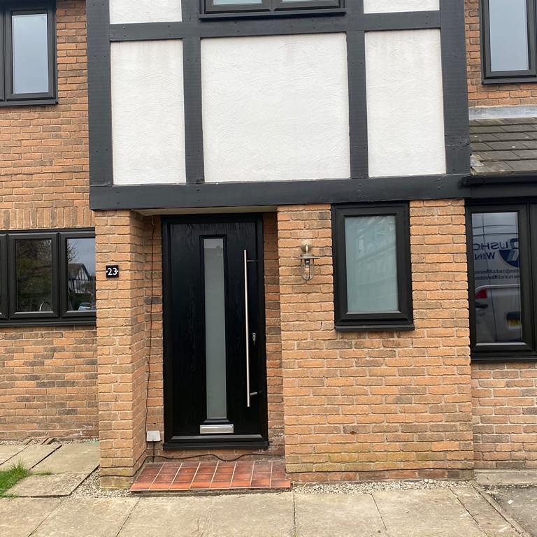 Image 1 - Black on White Distinction composite door installed in Gamston