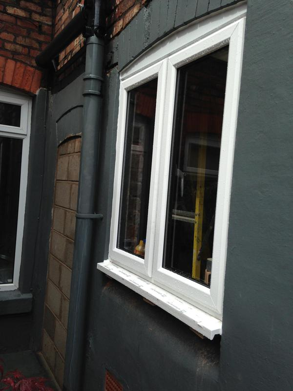 Image 29 - finished window which was bespoke sprayed as customer wanted grey inside and white outside