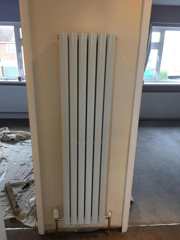 Image 3 - Vertical designer radiator fitted to fit in with extension